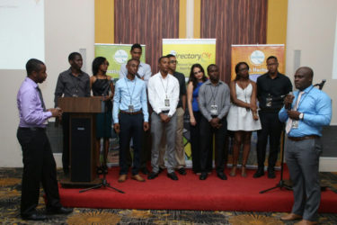 CEO of Intellect Storm Rowen Willabus (right) and Intellect Storm partner Ronson Grey (left) present the team (centre) that worked tirelessly in the design and development of Directory.gy.