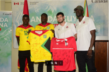 Golden Jaguars Captain Colin nelson (2nd from left) and Canada's Captain Maxime Crépeau (2nd from right) displaying the signed team jerseys featuring the complete team rosters ahead of their historic showdown while other members of the respective teams inclusive of Guyanese Dwight Peters (left) look on.
