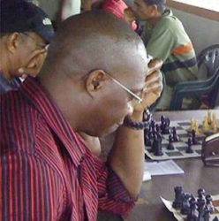 Frankie Farley (in photo) examines the chess board for flaws to his move sequence before he commits to his next move. Farley is contesting the presidency of the Guyana Chess Federation. He is the CEO of Silicon Green Inc and has experience in managing local and foreign companies. Frankie is a veteran chess player and is committed to popularizing the enduring mind game among Guyanese.