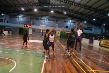 Jaleel Duke of President's College attempting a jump shot against St. Rose's High during their matchup of the National Schools Basketball Festival (NSBF) Georgetown and East Coast Regionals at the Cliff Anderson Sports Hall.