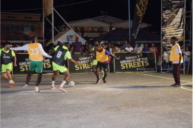 Action between Team Magics and Attackers in the Guinness of the Streets Linden edition at the Mackenzie Market Tarmac Friday.