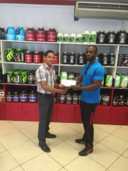 CEO of Fitness Express, Jamie McDonald hands over the sponsorship cheque to Paul Adams.