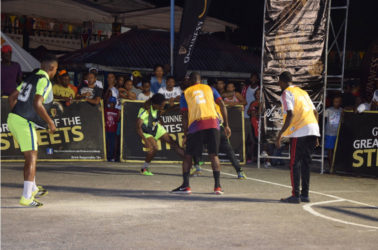 Joel McKennon (2nd from left) of Magics battling for possession of the ball against a  Retrieve Unknowns player during their team's matchup in the Linden Guinness of the Streets at the Mackenzie Market Tarmac.