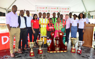 Members of the launch party at the 6th Annual Digicel u-18 Secondary Schools Championship inclusive of Director of Sports Christopher Jones (left), GFF President Wayne Forde (2nd from left), Digicel CEO Kevin Kelly (4th from right) and Digicel Marketing Manager Jacqueline James (right).