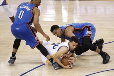 Golden State Warriors guard Stephen Curry (30) gains control of a loose ball next to Oklahoma City Thunder guard Andre Roberson (21) and guard Russell Westbrook (0) in the third quarter in game two of the Western conference finals of the NBA Playoffs at Oracle Arena. Mandatory Credit: Cary Edmondson-USA TODAY Sports