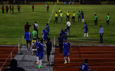 Members of Pele FC in the process of walking off the field in a protest which led to the abandoning of their fixture against Alpha United in the GFF Stag Beer Elite League at the Leonora Sports Facility.