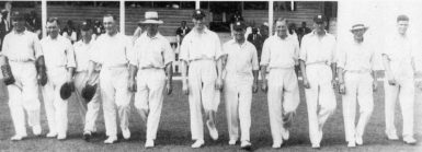The England team walks on to field. From left: Les Ames, Patsy Hendren, Andy Sandham, Wilfred Rhodes, Bob Wyatt, the Hon Fred Calthorpe (captain), Jack O'Connor, Ewart Astill, Nigel Haig, George Gunn, Bill Voce, West Indies v England, Barbados, January 11, 1930. (ESPNcricinfo photo)