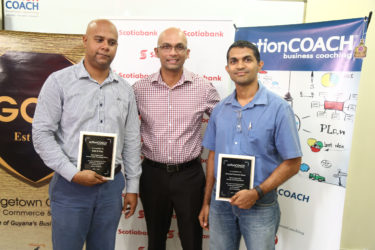 President of the GCCI Vishnu Doerga (centre) with representatives of Rid-O-Pes and Oriental Furniture Store, which were recognised for being the most improved one-on-one and group coaching clients, respectively, by ActionCoach.