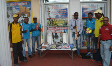 Representatives of Regal Sports and Rawle's Communication Agency with the sports equipment donated. .
