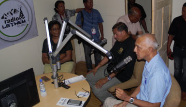 Minister of Communities, Ronald Bulkan speaking on the first radio programme after the launch, along with Minister of Indigenous People's Affairs, Sydney Allicock (centre) and Minister of Public Communications, Cathy Hughes.