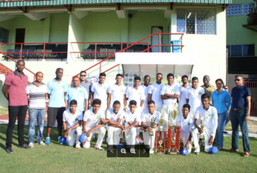 The victorious Demerara U19 team share a photo with: from left, Chairman of national cricket Selectors Rayon Griffith, Junior Chairman Selector Nazimul Drepaul Coach Clive Grimmond and GCB Secretary Anand Sanasie (far right)