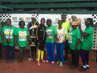 Some of the prize winners along with the organizers of the Golden Jubilee Independence' meet pose for a photo following the presentation ceremony at the GNS Complex yesterday.