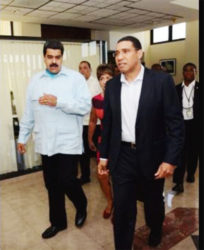 Venezuelan president Nicolas Maduro (left) talks with Prime Minister Andrew Holness on arrival at Jamaica House yesterday morning