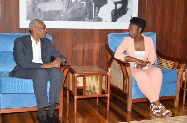 Harvard-bound US-based Guyanese student Kelly Hyles chatting with President David Granger yesterday during a meeting at his office. Hyles's acceptance to 21 colleges across the United States, including all eight Ivy League schools, had spread across social media like wildfire last month. (See centre pages)