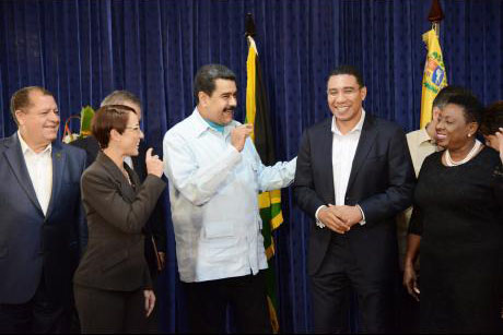 Venezuelan President Nicolás Maduro (centre) chats with (from left) Audley Shaw, minister of finance and the public service; Senator Kamina Johnson Smith, minister of foreign affairs and foreign trade; Prime Minister Andrew Holness; and Olivia 'Babsy' Grange, minister of entertainment, sport, culture, and gender affairs, at Jamaica House on Sunday.