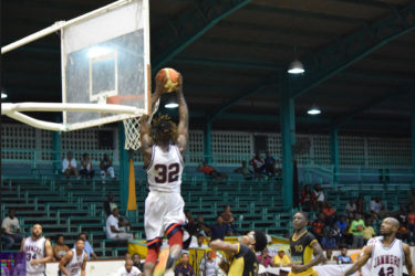 Winston Robinson of DC Jammers in the process of completing the monstrous 'alley-oop' during his side's win over Road to Mecca champs Colts at the Cliff Anderson Sports Hall. Back page picture