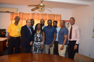 National triple jump record holder, Troy Doris (fourth from right) pose for a photo along with members of his family, GOA head, K Juman-Yassin, AAG president, Aubrey Hutson and Chef-De-Mission, Garfield Wiltshire.
