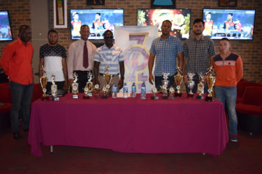 Organisers of the inaugural Professional Key Shop and the Wind Jammer Hotel Golden Mile along with some athletes and president of the AAG, Aubrey Hutson pose for a photo following the launch yesterday at 704 Sports Bar.