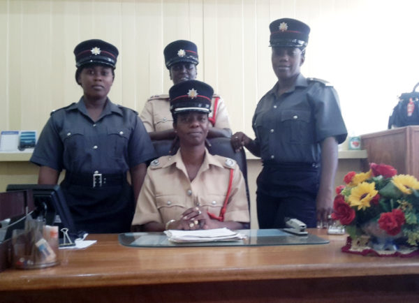 Divisional Fire Officer Administration Jacqueline Greene (seated) is flanked by Station Officer Marcia Bell (centre) and Firewomen Shavea Jordan (right) and Sophia Boucher (left).