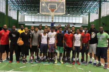 Members of the shortlisted Boys u-16 squad posing with members of the coaching staff following a training session at the Cliff Anderson Sports Hall.