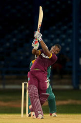 Opener Evin Lewis hits through the off-side during his unbeaten 71 against South Africa on Sunday. (Photo courtesy WICB Media)