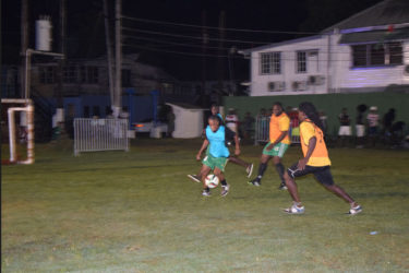 Terrence Lewis (right) of Old School Ballers trying to initiate an attacking play while being watched closely by Job Caesar of Cross Street during the opening fixture of the Ministry of Health/Petra Soft Shoe Championship at the Santos Training Area at the Square of the Revolution.