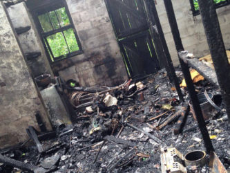The burnt remains inside the house after the fire.