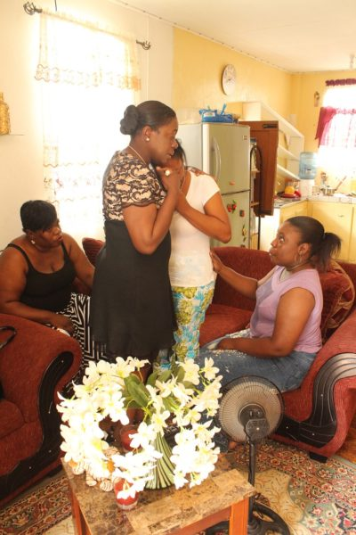Minister Nicolette Henry (second from left) consoling Alieka Davis