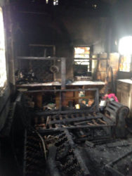The destroyed kitchen and living room area after the fire