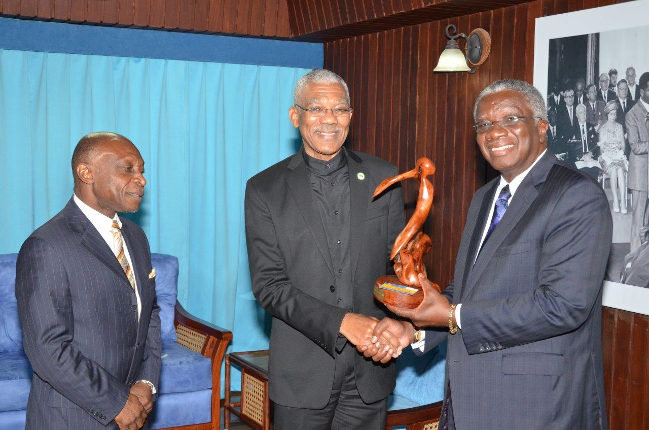 This Ministry of the Presidency photo shows Barbadian Prime Minister Freundel Stuart (right) presenting a gift to President David Granger. Foreign Minister Carl Greenidge is also in the photo.