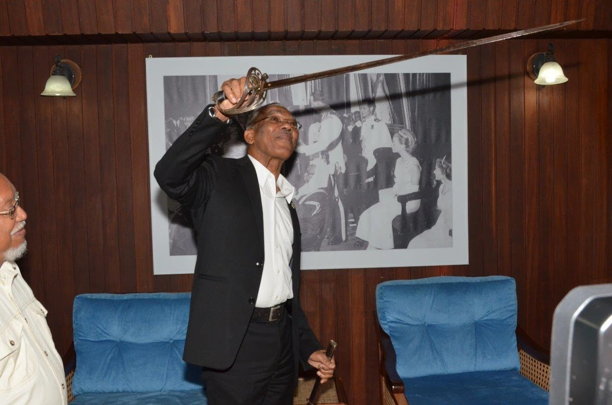 President David Granger holding the weapon closer to the light to examine its condition