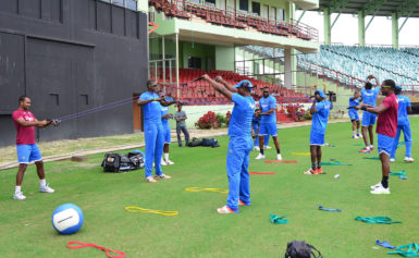 Some of the West Indies players doing stretches during the first training session at Providence.(Orlando Charles photo)