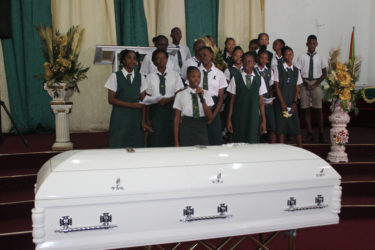 Students of Kevon Scipio's school paying him tribute in song yesterday.