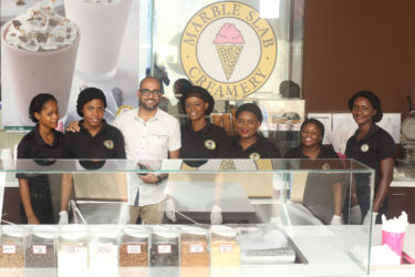 Marketing Manager of Marble Slab Creamery, Navin Singh, posing with other Marble Slab employees at their launching yesterday.