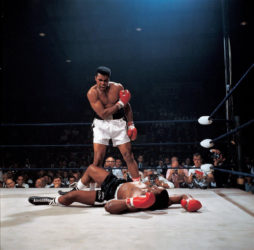 Muhammad Ali stands over a fallen Sonny Liston during their second fight May 25, 1965.