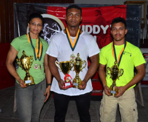 Winner's Row! Nadina Taharally, Carlos Peterson and Romario Gonsalves pose with their spoils following the Claude Charles Intermediate and Master's Championship yesterday at the Critchlow Labour College. (Orlando Charles photo)