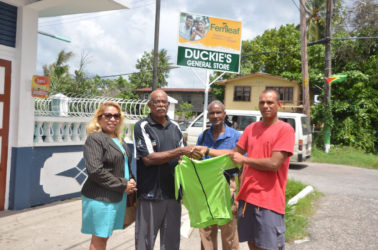 Florida based Victor Rutherford (left) who is the coordinator of the GCANA, yesterday handed over the kits to Vice President of the Guyana Cycling Federation (GCF), Paul Choo-Wee-Nam in the presence of GCF's Gemma Williams and William Howard.