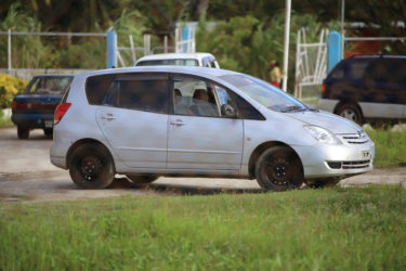 The vehicle suspected to have been used to transport the persons who threw a grenade near the vehicle of Kaieteur News publisher Glenn Lall on Saturday evening was parked inside the East La Penitence Police station yesterday afternoon.