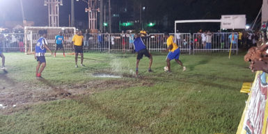 Devon Charles (right) of North East La Penitence trying to evade the impending challenge from Devon Dooker of Albouystown during their matchup at the Santos Training Area in the Ministry of Health/Petra Organization Soft Shoe Championship.