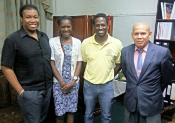 SASOD Representatives (l-r) Projects Coordinator, John Quelch; Advocacy and Communications Officer Schemel Patrick and Managing Director, Joel Simpson pose with Minister of Public Health, Dr. George Norton.
