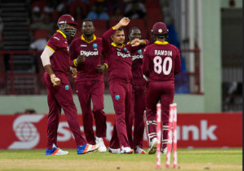 Some West Indies players celebrate the fall of  a wicket during Match 2 of the Ballr Cup Tri-Nation Series between West Indies and Australia at Guyana National Stadium, Providence on Sunday. Photo by WICB Media/Randy Brooks of Brooks Latouche Photography
