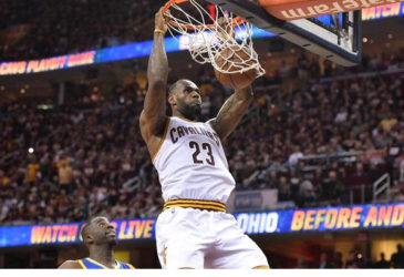 Cleveland Cavaliers forward LeBron James (23) dunks the ball in front of Golden State Warriors forward Draymond Green (23) during the four quarter in game three of the NBA Finals at Quicken Loans Arena. Mandatory Credit: Ken Blaze-USA TODAY Sports