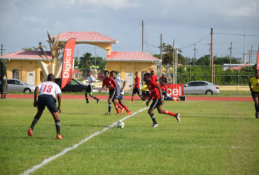 Action between Vreed-en-Hoop Secondary (white) and L'Aventure Secondary in the West Demerara leg when the 6th edition of the Digicel National U18 Secondary Schools Football Championship started at the Leonora Sports Facility.