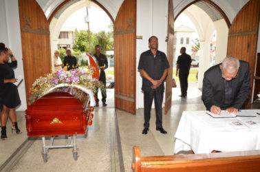 President David Granger signing the book of condolence for Jules Kranenburg at the Cathedral of the Immaculate Conception, Brickdam, Stabroek. (Ministry of the Presidency photo)