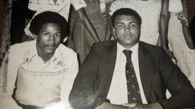 Muhammad Ali (seated, centre) poses with guests at a reception held in his honour at Hamilton Green's home in 1979.