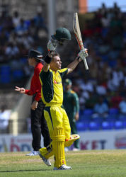 Opener David Warner celebrates his sixth ODI hundred at Warner Park on Saturday. (Photo courtesy WICB Media)