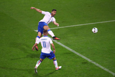 Graziano Pelle volleys home Italy's second goal.