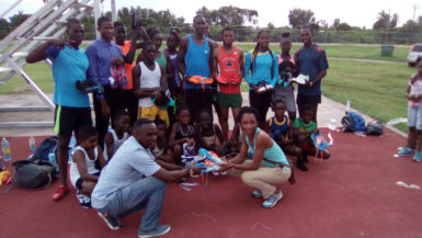 Some of the Running Brave Athletic Club (RBAC) athletes pose with their Adidas and Nike spikes presented by former national 800 and 1500m athlete, Robin Bishop.