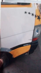 The damaged driver side bus door.