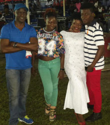 T'shanna Cort (second, right) after winning the Junior Calypso Competition with designer Nelsion Nurse (right) and her mentors Burchmore Simon (left) and Melissa 'Vanilla' Roberts